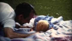 (8mm Film) 1951 Dad Playing Baby on Blanket Stock Footage