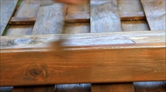 Applying glaze with brush on wood Stock Footage