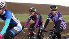 Group of cyclists riding up a hill - stock footage