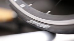 Detail of bicycle wheel on roller - stock footage