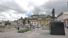 Walking near the statue on Boulevard 24 de Mayo in Quito Stock Footage