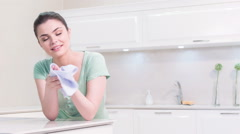 Woman cleaning her hands in kitchen Stock Footage