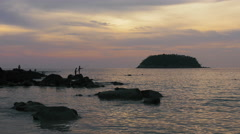 Silhouettes of kids fishing on rocks in Thailand - 4k clip 2 Stock Footage
