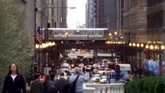Traffic on the West Washington Street with a Chicago 'L' train  at background. Stock Footage