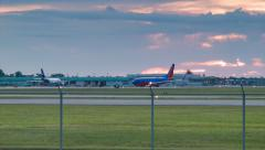 New Orleans Airport Traffic Early Evening with Sunset Sky Colors - stock footage