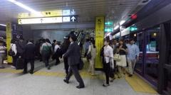 Passengers at Tokyo's Shibuya metro station Stock Footage