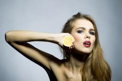 Suggestive blonde girl portrait with orange Stock Photos