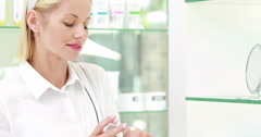 Pretty blonde trying beauty product - stock footage