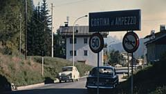 Cortina d'Ampezzo, Italy 1967: car passing in the street Stock Footage