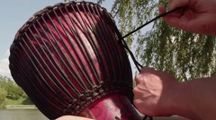 Drummer, drum sets, pulling ropes, lake, willow branches Stock Footage