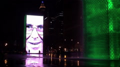 Silhouettes at the night illumination of Crown Fountain in Millennium Park. Stock Footage