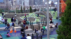Children playing on playground in the Play Garden of Maggie Daley Park. Chicago Stock Footage