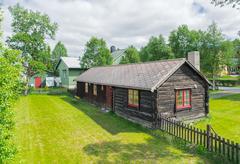 Scandinavian black log house Stock Photos