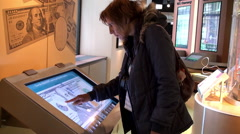 Girl tourist in the Money Museum at the Chicago Fed. Stock Footage