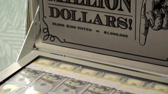 One million dollars in $100 bills in a suitcase. Stock Footage