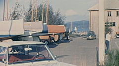 Ammersee, West Germany 1967: cars parked in front of the lake Stock Footage