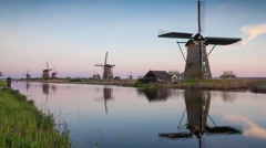 Famous Kinderdijk mills on the water channel Stock Footage