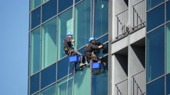 Industrial climbers washing skyscrapers windows Stock Footage