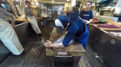 Fresh Tuna main cut by professional Japanese tuna handlers at Tsukiji market Stock Footage