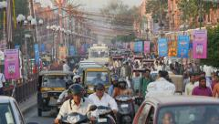 India, traffic drives through the streets of Jaipur during rush hour Stock Footage