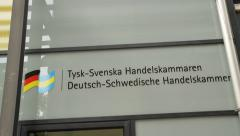 Pan to Swedish - German chamber of commerce sign in Stockholm Stock Footage