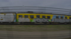 Tracking shot of a train depot taken from a passing train Stock Footage