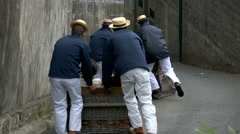 TL 4K Madeira Funchal Traditional Basket sledges Toboggan Ride Carreiros Do Stock Footage