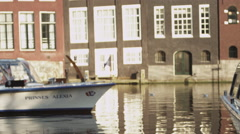 AMSTERDAM, NETHERLANDS - CIRCA 2013: Shot of a cruising ferry boat with people Stock Footage