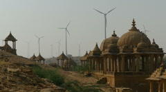 Wind farm behind classic temple complex in India Stock Footage