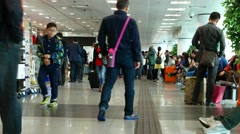 China ferry terminal interior, duty free zone, passengers walking and waiting Stock Footage