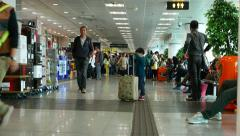 Little boy with suitcase larger then his height, China Ferry terminal Stock Footage