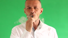 Vaping e cigarette in front of  green background Stock Footage