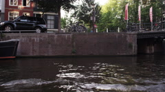 Going under a bridge in the canal in Amsterdam, Netherlands Stock Footage