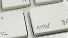 Finger Push Command (Cmd) Key Button of the Keyboard. Close up slow panorama - stock footage