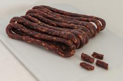 Appetizing dried spicy hunting  sausages - stock photo