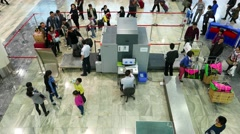Passengers queue security check scanner in airport, top angle view Stock Footage