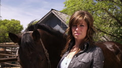Slow motion shot of a woman grooming a horse. Stock Footage