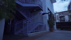 Man Does Parkour Vault Over Stair Railing Stock Footage
