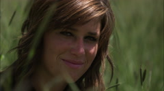 Stock Video Footage of Slow motion shot of the face of a pleasant woman.