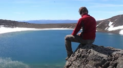 Man enjoying the view over blue lake in Tongariro Stock Footage
