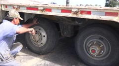 Stock Video Footage of ,replacing flat tire,Big Rig tire change,