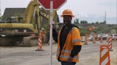TIlt shot of a black road construction worker. Stock Footage