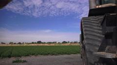 Farmer and big farm equipment Stock Footage