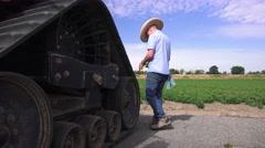 Cowboy farmer using computer, tomato farm Stock Footage