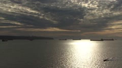 Vancouver Canada Cargo ships docked in bay at sunset Stock Footage