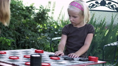 Slow pan of two little girls playing checkers - stock footage