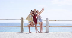 Teenage girls taking selfie at beach on summer vacation centre frame composition - stock footage