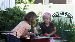 Slow static shot of two little girls playing checkers - stock footage