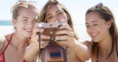 Close up of three teenage girl friends taking selfie photograph with vintage Stock Footage