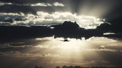 Airplane on  approach flight in a eventide cloudy  sky Stock Footage